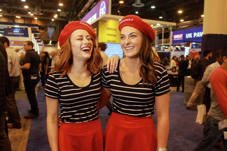 Sarah Grimes, left, and Rachael Reed dressed for work at the Air France & KLM booth at OTC.    (For the Chronicle/Gary Fountain, May 2, 2018) Photo: Gary Fountain, For The Chronicle / For The Chronicle / Copyright 2018 Gary Fountain