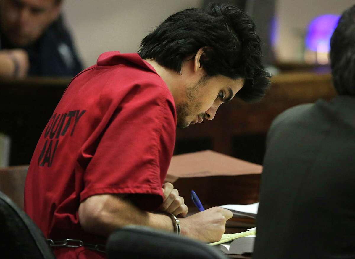 Murder suspect Joshua Manuel Lopez, accused of killing Elmendorf Police Chief Michael Pimental, takes notes as he sitsduring a court hearing June 4, 2015. Two mental health experts believe he was insane at the time he shot Pimental during a traffic stop. Pimental, 64, had a long career as a police officer.