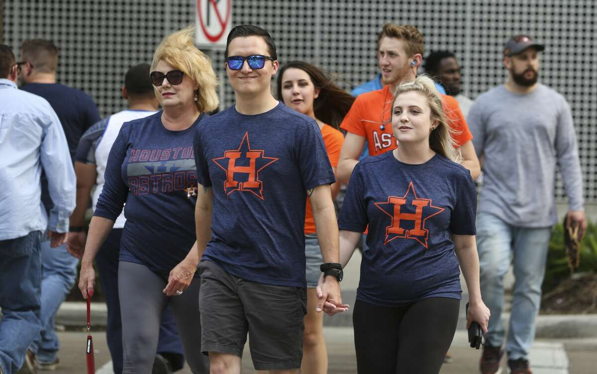 Houston Astros fans cross the Polk Street and Avenida De Las Americas toward Minute Maid Park while Houston Rockets fans head to Toyota Center on Wednesday, May 2, 2018, in Houston. The Astros played Game 3 of a four-game series against the New York Yankees and the Rockets played Game 2 of the NBA second-round playoff series series against Utah Jazz on Wednesday night. ( Yi-Chin Lee / Houston Chronicle )
