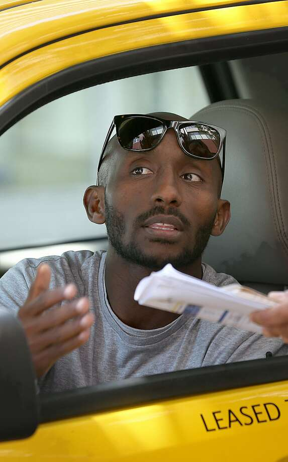 Taxi driver Daniel Habtu, 34 years old, waits for customers outside Marriott Hotel on Wednesday, May 2, 2018 in San Francisco, California. Photo: Liz Hafalia / The Chronicle