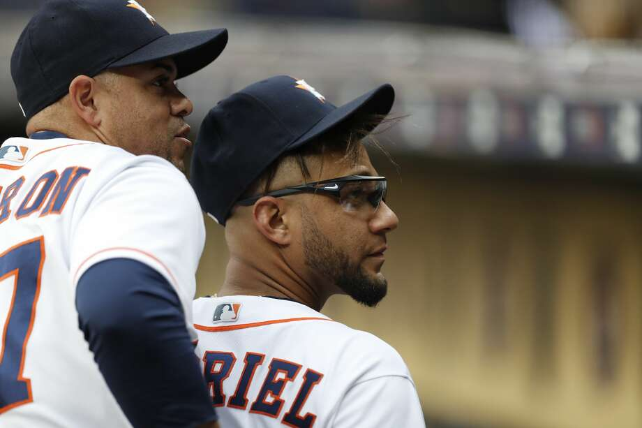 Houston Astros first baseman Yuli Gurriel (10) and first base coach Alex Cintron (37) before the start of an MLB game at Minute Maid Park, Wednesday, May 2, 2018, in Houston. ( Karen Warren  / Houston Chronicle ) Photo: Karen Warren/Houston Chronicle