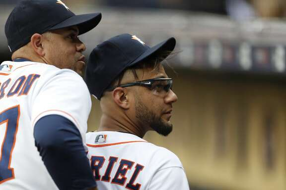 Houston Astros first baseman Yuli Gurriel (10) and first base coach Alex Cintron (37) before the start of an MLB game at Minute Maid Park, Wednesday, May 2, 2018, in Houston. ( Karen Warren  / Houston Chronicle )