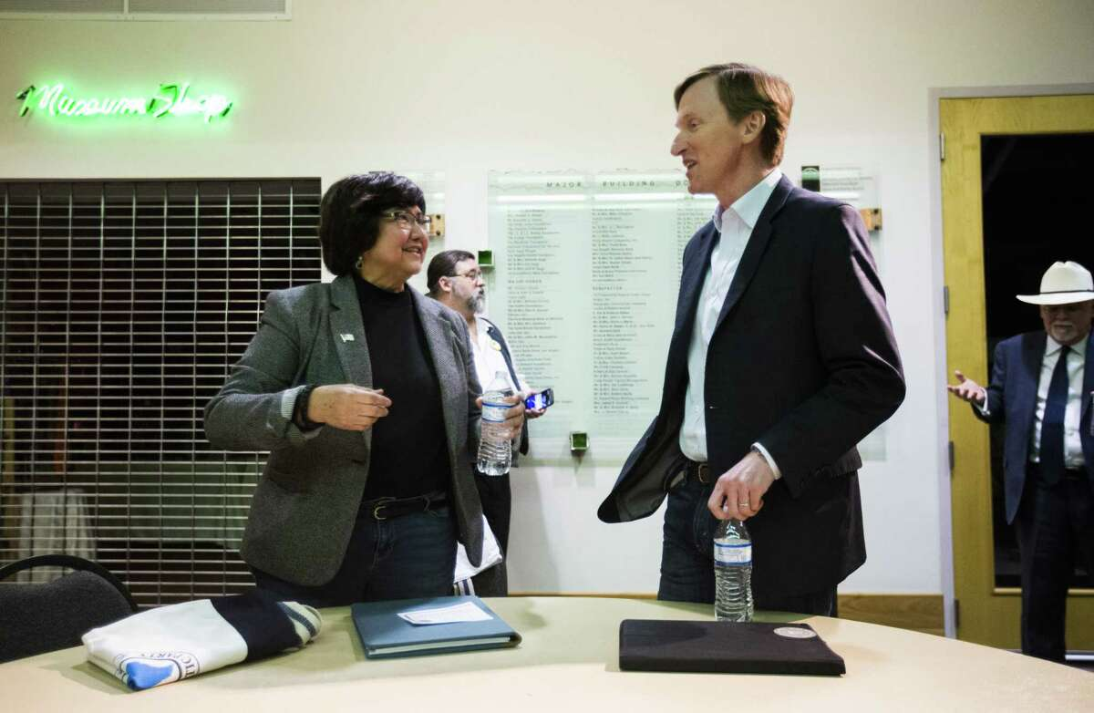 Gubernatorial candidates Lupe Valdez, left, and Andrew White, right, greet each other before a democratic gubernatorial candidate forum hosted by Tom Green County Democratic Club on Monday, January 8, 2018 at the San Angelo Museum of Fine Arts in San Angelo, Texas. (Ashley Landis/The Dallas Morning News)