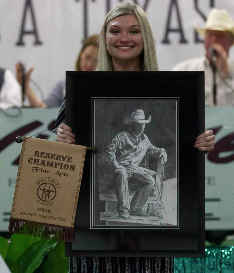 Shelby Hanson of Splendora High School won reserve champion for fine art during the junior non-livestock auction at the Montgomery County Fair & Rodeo April 16 in Conroe. More than 1,000 exhibitors showed in one of six divisions. Photo: Jason Fochtman, Staff Photographer / © 2018 Houston Chronicle