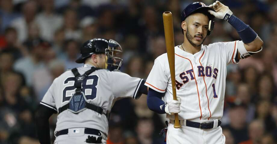 Frustrating scenes like this have become all too common at home for Carlos Correa and the Astros this season. Photo: Karen Warren/Houston Chronicle