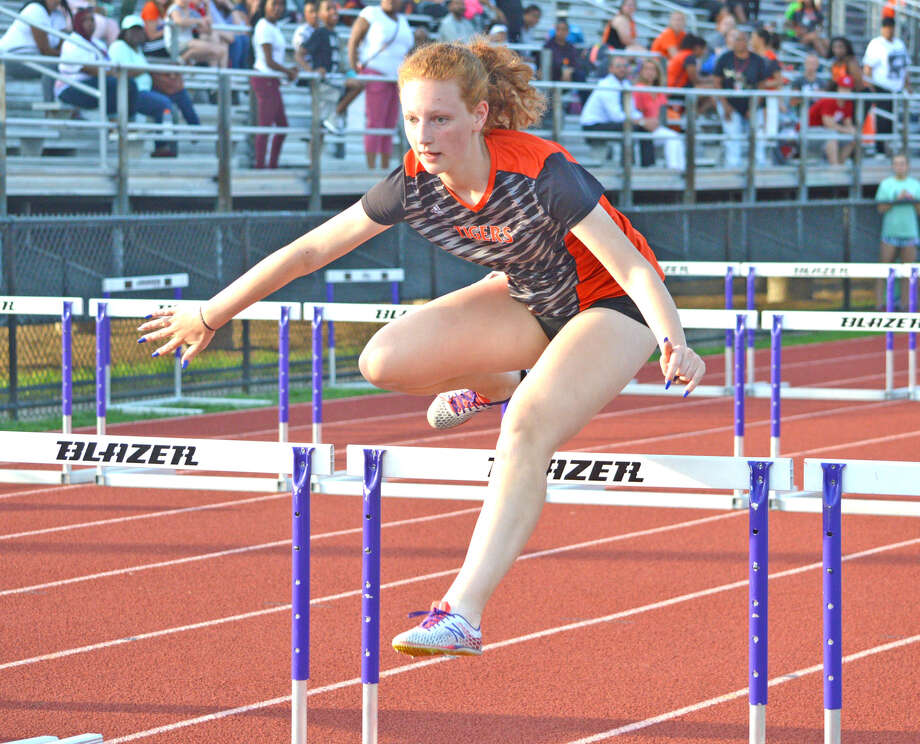 Edwardsville freshman Bre Kircher competes in the 100-meter hurdles during Wednesday's Southwestern Conference Meet at Collinsville.