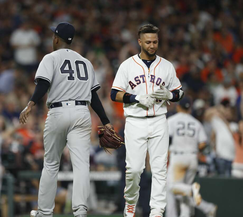 New York Yankees starting pitcher Luis Severino (40) walks past Houston Astros first baseman Yuli Gurriel (10) after the seventh inning of an MLB game at Minute Maid Park, Wednesday, May 2, 2018, in Houston. ( Karen Warren  / Houston Chronicle ) Photo: Karen Warren/Houston Chronicle