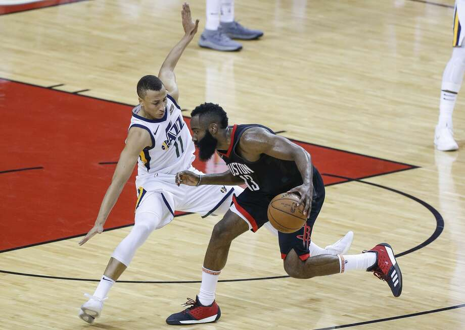 Utah Jazz guard Dante Exum (11) attempts to defend against Houston Rockets guard James Harden (13) during the second half of Game 2 of the NBA second-round playoff series at the Toyota Center Wednesday, May 2, 2018 in Houston. (Michael Ciaglo / Houston Chronicle) Photo: Michael Ciaglo/Houston Chronicle