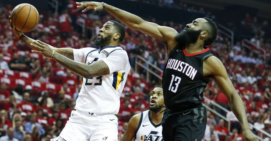 Jazz forward Royce O'Neale takes the ball to the basket past James Harden during the first half. O'Neale was the only Jazz starter not to score in double figures. Photo: Brett Coomer/Houston Chronicle