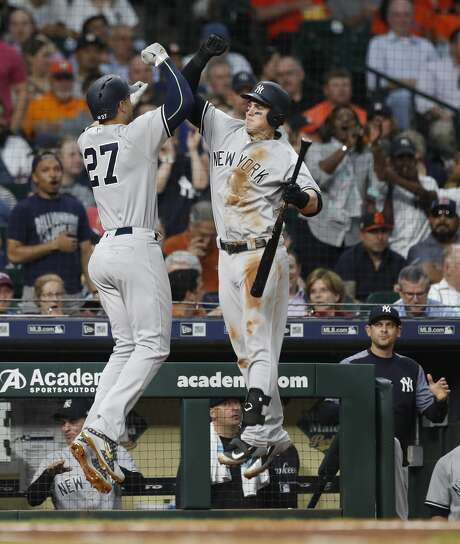 New York Yankees Giancarlo Stanton celebrates with Tyler Austin after hitting his second home run of the night off of Houston Astros starting pitcher Dallas Keuchel during the fourth inning of an MLB game at Minute Maid Park, Wednesday, May 2, 2018, in Houston. ( Karen Warren  / Houston Chronicle ) Photo: Karen Warren/Houston Chronicle