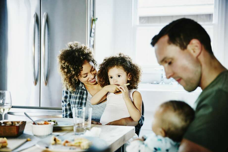 A new trend among parents who separate or divorce is to continue living together. It's more economical, and if the parents can have a friendly domestic partnership, it's great for the kids. Photo: Thomas Barwick/Getty Images