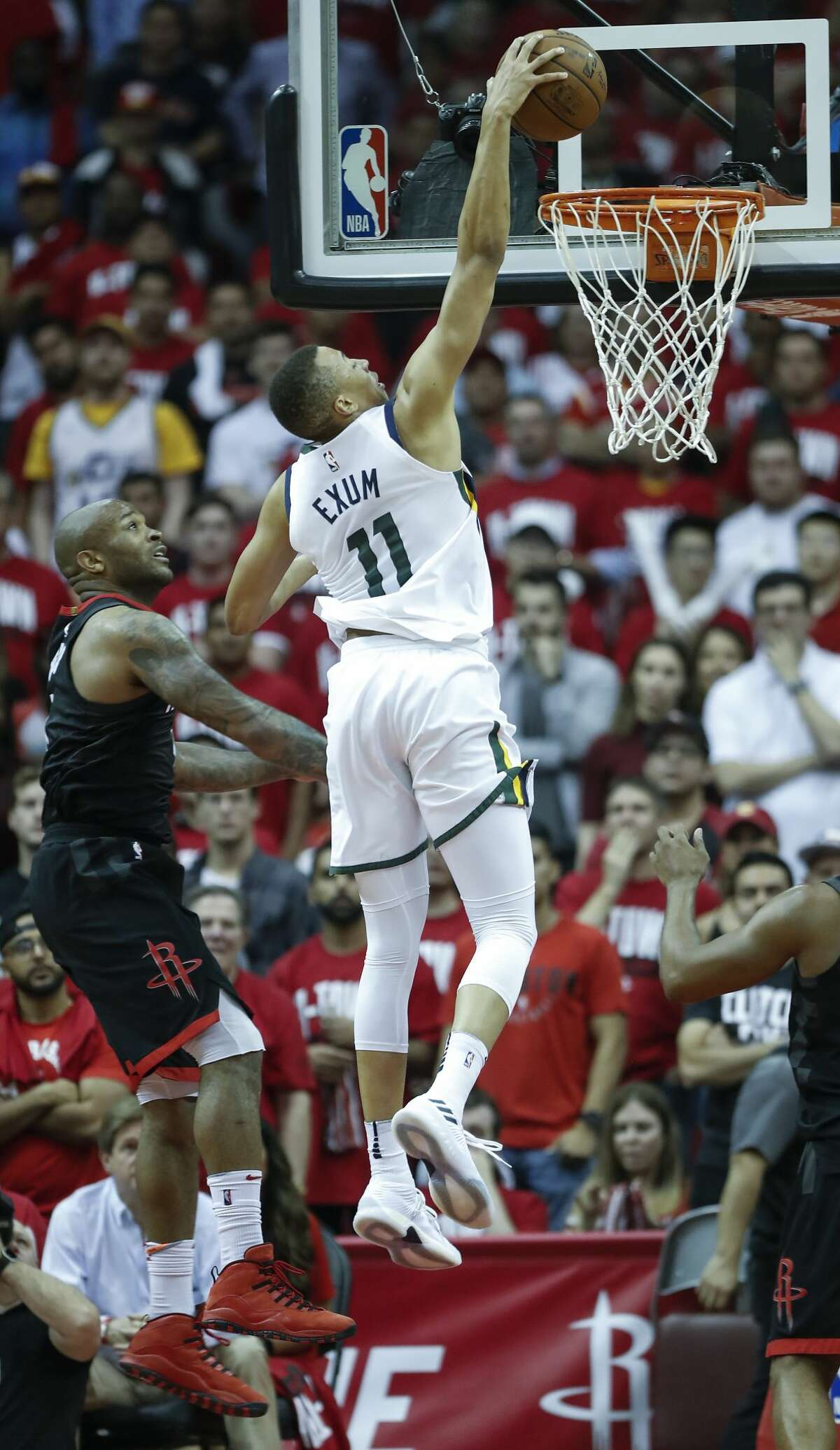 Utah Jazz guard Dante Exum (11) scores on a dunk after driving past Houston Rockets forward PJ Tucker (4) during the second half in Game 2 of an NBA basketball second-round playoff series at Toyota Center on Wednesday, May 2, 2018, in Houston. ( Brett Coomer / Houston Chronicle )