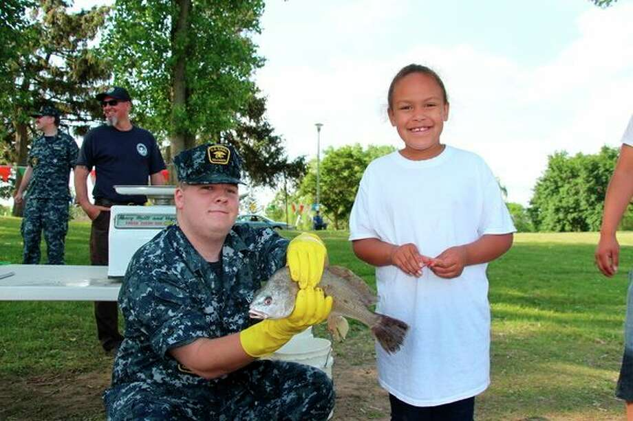 A young participant enjoys last year's annual Kids Free Fishing Day at Ojibway Island in Saginaw. (Photo provided by U.S. Fish and Wildlife Service)