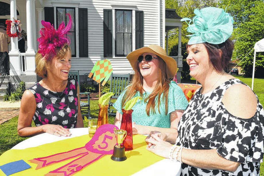 Ginny Fanning (from left), Brittany Henry and Audra Fanning Nelson share a few laughs May 6 during the Derby Day fundraiser at the historic Gov. Duncan Mansion. The annual event returns Saturday to the mansion as the 144th annual Kentucky Derby is run at Churchill Downs in Louisville, Kentucky. Photo:       Greg Olson | Journal-Courier