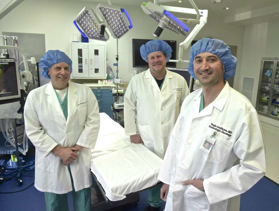 Dr David Goldenberg, left, Dr Karl Kulikowski and Dr Vaagn Andikyan, right, in a Danbury Hospital operating room. The doctors were part of a team from the hospital that removed a 132-pound tumor from a woman's ovary. May 2, 2018, at Danbury Hospital, in Danbury, Conn. Photo: H John Voorhees III / Hearst Connecticut Media / The News-Times
