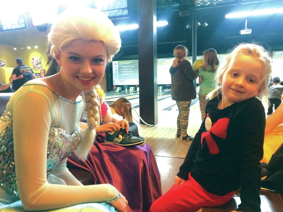 Avery Thornberry, 5, talks with a cast member from As You Wish, dressed up as Elsa from Disney's Frozen.