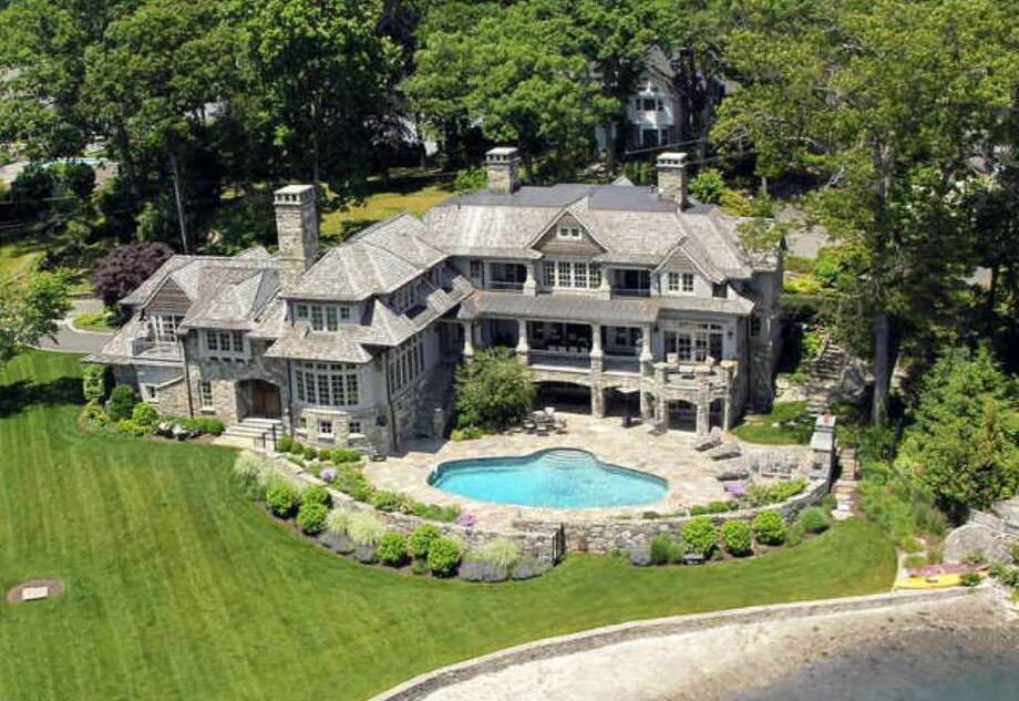 This home at 8 North Road, on Butler's Island in Darien, hit the market in June, and is priced at $13.2 million. Photo: Contributed Photo / Darien News