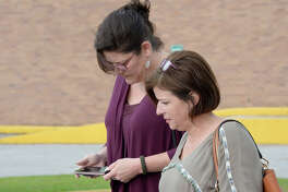 Helen Cox, left, exits the Hardin County Courthouse Thursday, May 03, 2018 after a new trial date was set. Cox is accused of stealing $70,000 from the Lumberton High School Band Booster Club.  Photo taken Thursday, May 03, 2018 Guiseppe Barranco/The Enterprise