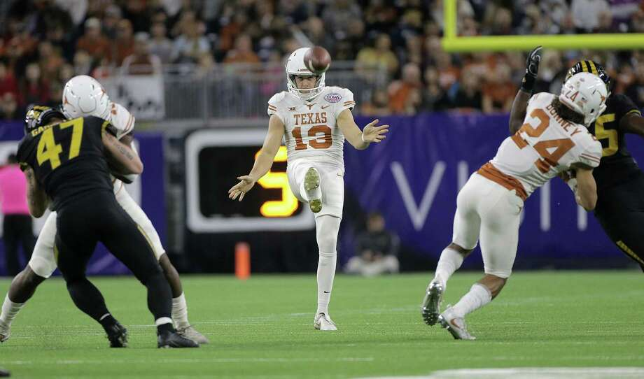 Texas Longhorns punter Michael Dickson (13) kicks the ball in the first half of the Academy Sports + Outdoors Texas Bowl against Missouri at NRG Stadium on Wednesday, Dec. 27, 2017, in Houston. Dickson was named MVP of the game. ( Elizabeth Conley / Houston Chronicle ) Photo: Elizabeth Conley, Chronicle / Houston Chronicle / © 2017 Houston Chronicle