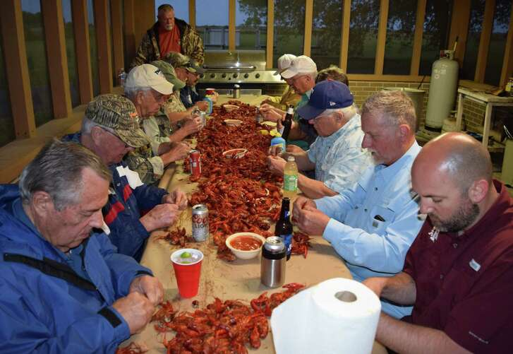 A table covered with tasty Louisiana crawfish provides a mudbug feast for members of the Sportsman Club of San Antonio during their annual spring fishing/eating adventure to the Coastal Club near Lake Charles.