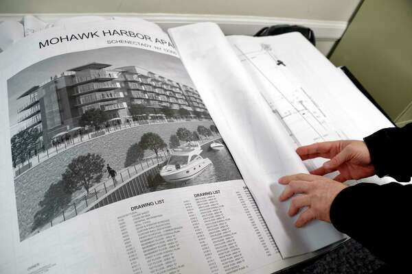 Chief of Codes Chris Lunn reviews plans for Mohawk Harbor Apartments at the code enforcement office in City Hall Friday April 27, 2018 in Schenectady, NY.  (John Carl D'Annibale/Times Union)