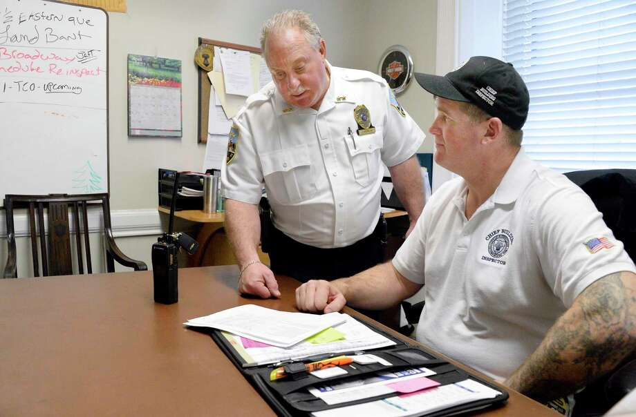 Assistant Police Chief Jack Falvo, left, and Chief of Codes Chris Lunn at the code enforcement office in City Hall Friday April 27, 2018 in Schenectady, NY.  (John Carl D'Annibale/Times Union) Photo: John Carl D'Annibale / 40043605A