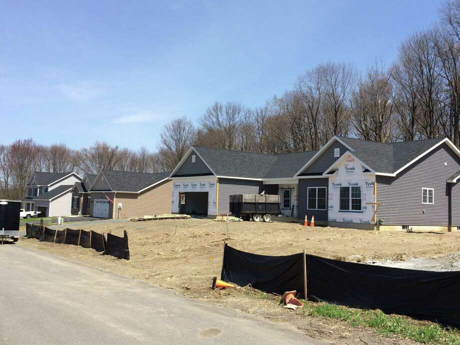 Homes on Kimberly Circle in North Greenbush were built by the company owned by the town's building inspector, Michael Miner. Miner said he has his colleagues in the building department do the inspections, and that he has spoken to the town attorney in the past to ensure he is violating no ethics guidelines. (Lauren Stanforth/Times Union)