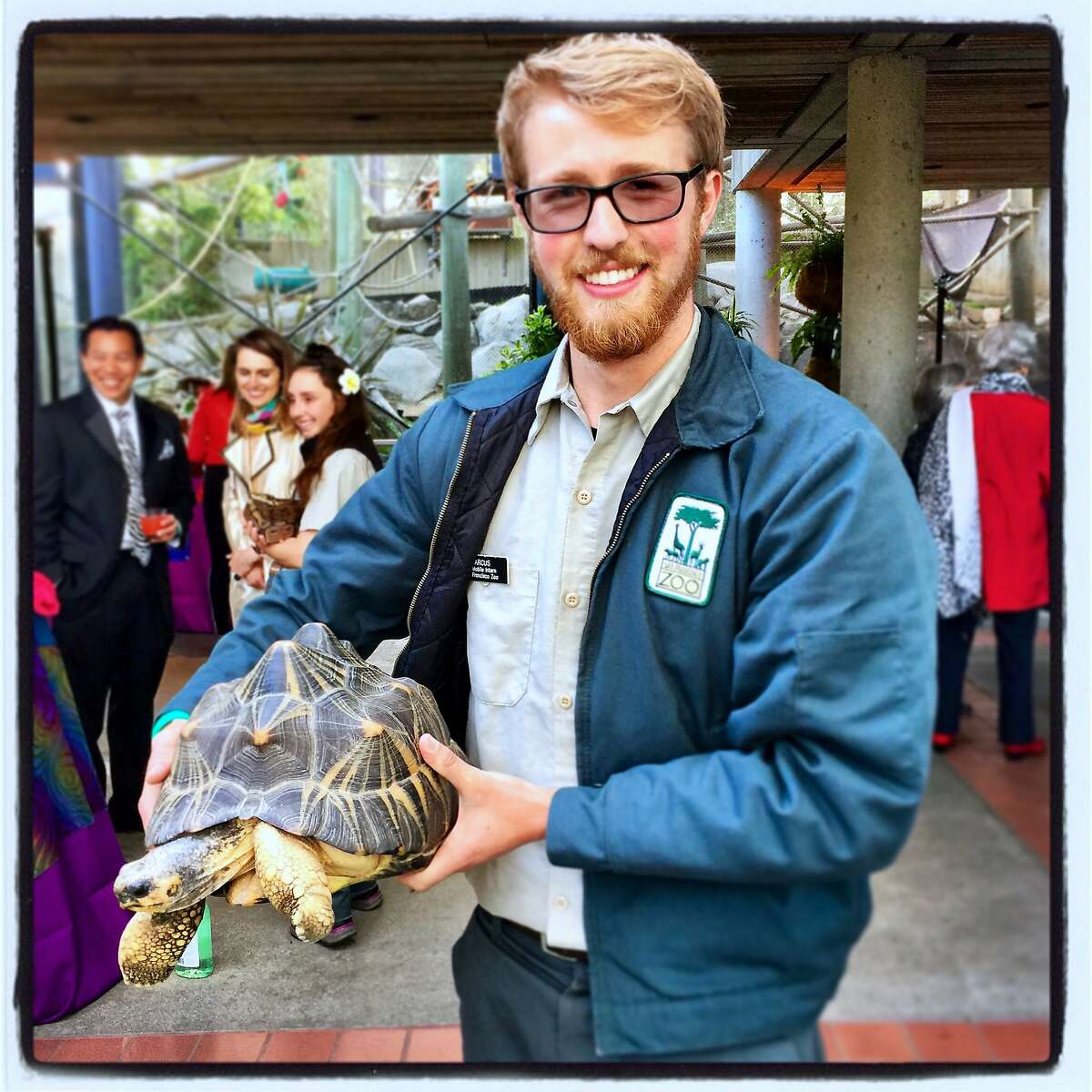 Zoo intern Marcus holds a Madagascar radiated tortoise at ZooFest. April 27, 2018.
