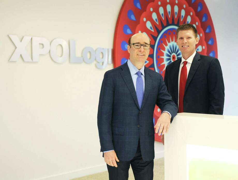 XPO Logistics CEO Bradley Jacobs, left, and President Troy Cooper pose at the XPO Logistics headquarters in Greenwich, Conn. Tuesday, July 25, 2017. Photo: Tyler Sizemore / Hearst Connecticut Media / Greenwich Time