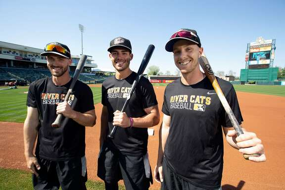 Sacramento River Cats outfielders Steven Duggar, from left, Chris Shaw and Austin Slater pose for a photograph before a home game at Raley Field on Thursday, April 26, 2018 in Sacramento, Calif.
