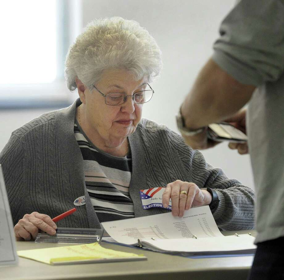 Judy Schlemmer checks names of voters at the Stony Hill Fire Department polling place wednesday. Bethel residents went to the polls Wednesday, April 11, 2018, to vote in the budget referendum. Photo: Carol Kaliff / Hearst Connecticut Media / The News-Times