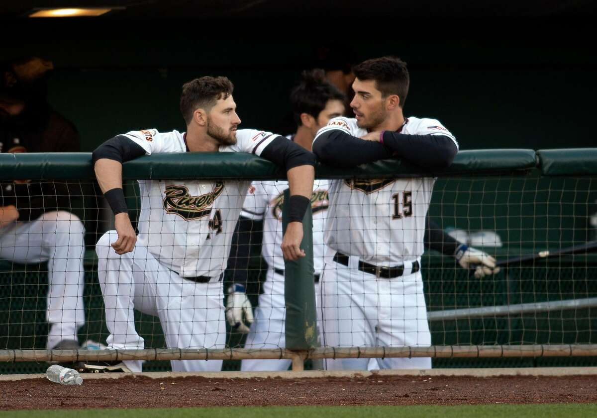 Sacramento River Cats outfielders Steven Duggar (14) and Chris Shaw (15) hang together in the dugout during the second inning of a Pacific Coast League baseball game.