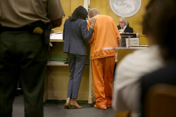Deputy public defender Anita Nabha with robbery suspect Kenneth Humphrey appear in court at Hall of Justice on Tuesday, May 1, 2018, in San Francisco, Calif. This case may determine the standard by which inmates can be held before trial.