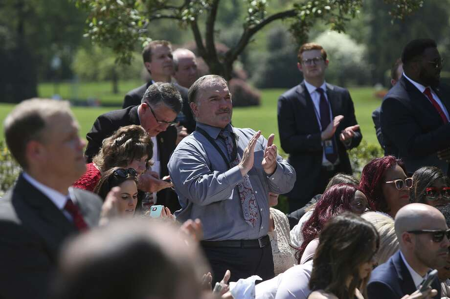 First Baptist Church of Sutherland Springs member and shooting survivor David Colbath stands to applaud at the conclusion of President Donald Trump's remarks during the National Day of Prayer service at the White House on Thursday, May 3, 2018. Photo: Lisa Krantz / SAN ANTONIO EXPRESS-NEWS / SAN ANTONIO EXPRESS-NEWS
