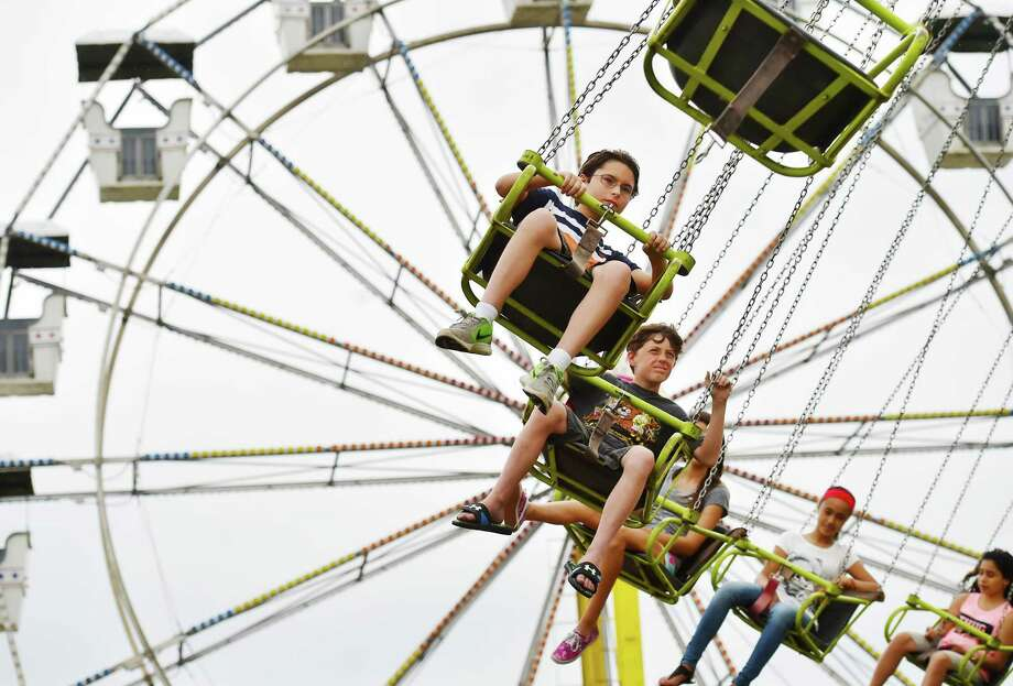 A little rain doesn't discourage these youngsters from riding the Yo Yo at the carnival at the 35th annual Savin Rock Festival in West Haven, Saturday, July 30, 2016.  (Catherine Avalone/New Haven Register) Photo: Catherine Avalone / New Haven RegisterThe Middletown Press