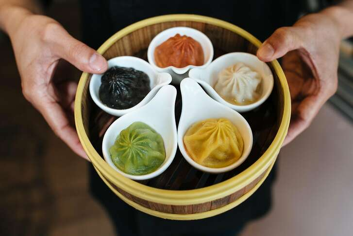 Dennis Leung, manager of Dragon Beaux, holds the Five Guys Xiao Long Bao at Dragon Beaux in San Francisco, Calif., Monday, April 30, 2018.