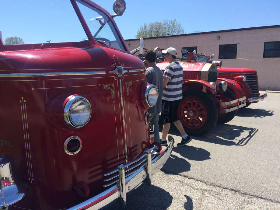 Three old fire trucks were among 20 vehicles on display at a car show Saturday, marking the Maryland Moats Lexow Insurance Agency's new renovations to its headquarters.