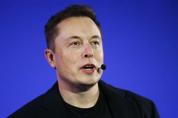 Tesla Motors Inc. CEO Elon Musk delivers a conference at the Paris Pantheon Sorbonne University as part of the COP21, United Nations Climate Change Conference, in Paris, Wednesday, Dec. 2, 2015. (AP Photo/Francois Mori)