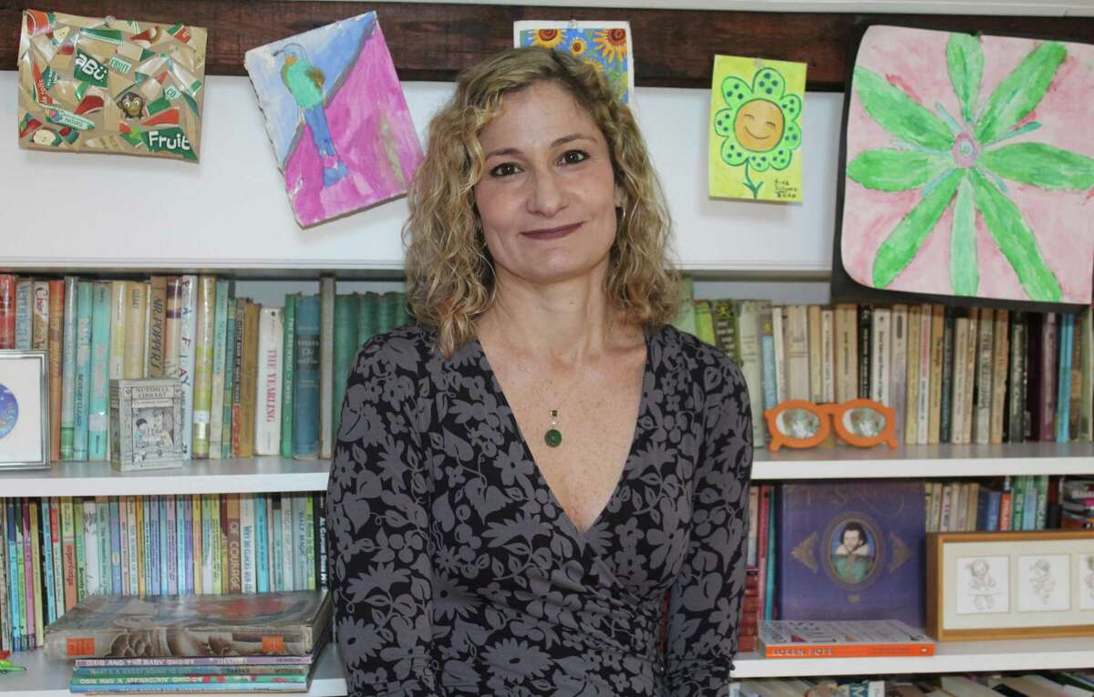 Christy Ottaviano poses in her Fairfield home. A children's book publisher, Ottaviano has her own imprint within Macmillan Children's Publishing Group.