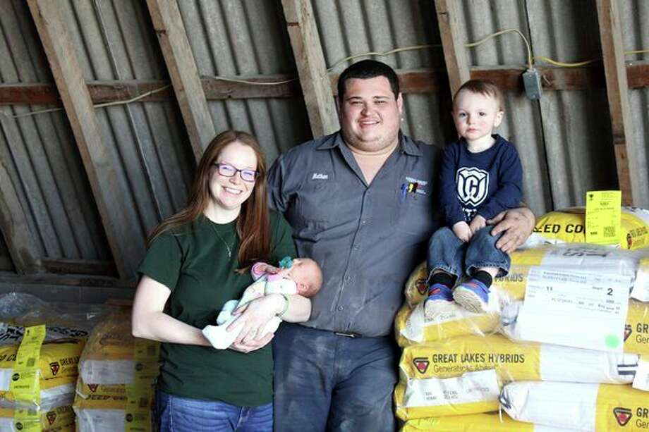 Pictured is the Engelhard family of Unionville. Amyis holding their baby, Jordana. Also pictured is her husband, Nathan, and son, Lawson. They operate an organic farm near Unionville. (Brenda Battel/Huron Daily Tribune)