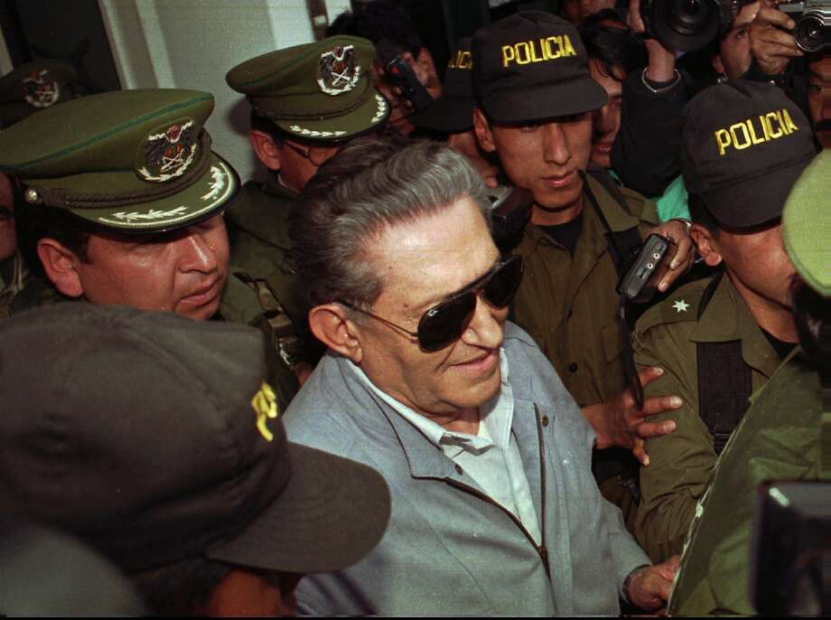 687dcbee Bolivia's jailed, ex-dictator Luis Garcia Meza is surrounded by police as  he leaves