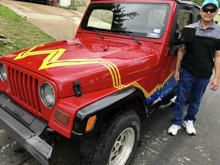 Carlos poses with his granddaughter's custom-painted Wonder Woman Jeep. The retiree, who doesn't want his last name mentioned, drives the Jeep once a day in San Antonio and gets a lot of requests for photos. Photo: René A. Guzman /San Antonio Express-News