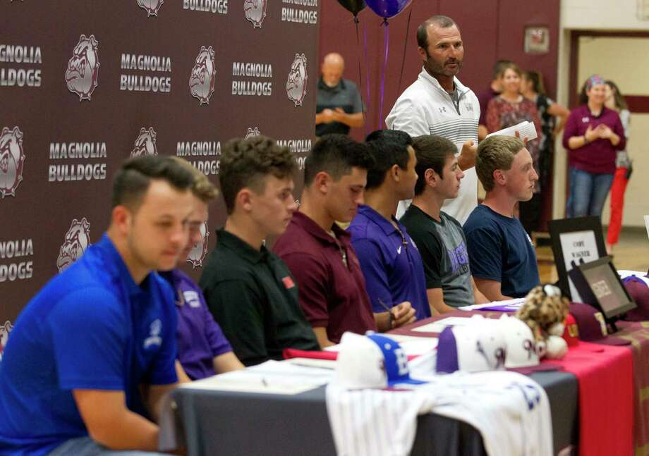 Magnolia head coach Taylor Shiflett talks about seven members of the baseball team as they prepare to sign for various colleges during a signing ceremony at Magnolia High School, Thursday, May 3, 2018, in Magnolia. Photo: Jason Fochtman, Staff Photographer / © 2018 Houston Chronicle