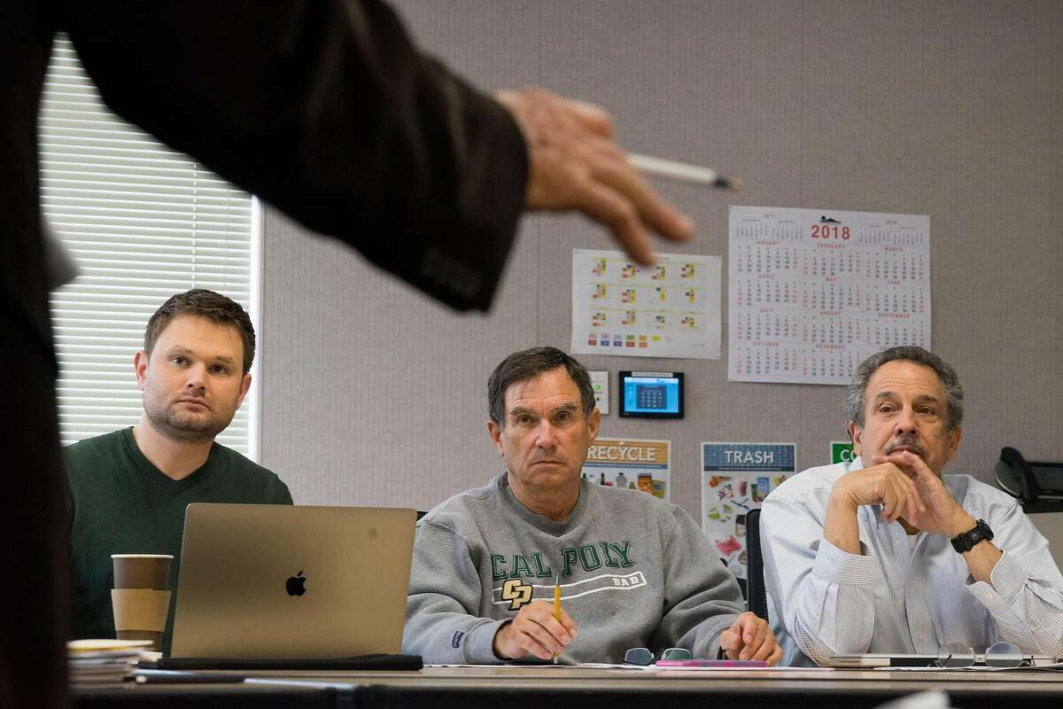 Left to right, council members Chris Clark, John McAlister and Mayor Lenny Siegel listen to public comment during a sub committee meeting at Mountain View City Hall in Mountain View, Calif. on Thursday, May 3, 2018. Mountain View is considering raising up to $10 million through a new tax that would raise business license fees and tax large businesses per employee. The tax, which would need to be approved by voters, would directly impact the city's largest employer, Google, which has more than 20,000 employees there.