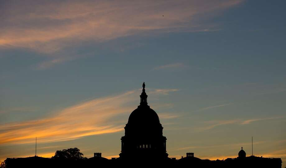 In this Sept. 15, 2013, file photo, the U.S. Capitol dome is silhouetted by the sunrise. Doctors who treat Medicare patients would get a last-minute reprieve from a scheduled 24 percent cut in their reimbursements from the government under a bill that�s on track to pass the House. It would be the 17th time Congress has stepped in with a temporary fix to a poorly designed Medicare fee formula that dates to a 1997 budget law. House action comes after efforts to permanently fix the formula appear to have fizzled.  (AP Photo/Carolyn Kaster, File) Photo: Carolyn Kaster, Associated Press