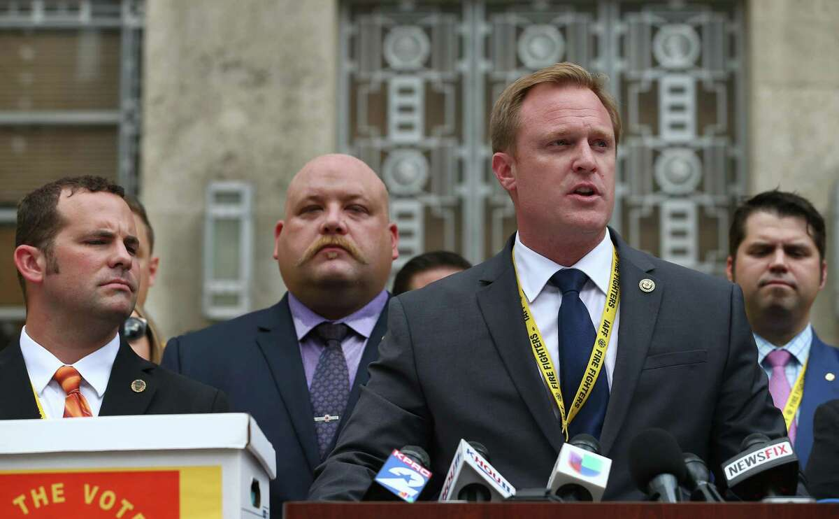 """Patrick """"Marty"""" Lancton, president of the Houston Professional Fire Fighters Association, foreground, talks to media about the more than 32,000 signatures Houston firefighters collected in an effort to put equal pay on the ballot during a press conference outside City Hall Monday, July 17, 2017, in Houston. ( Godofredo A. Vasquez / Houston Chronicle )"""