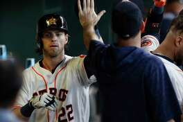 Houston Astros Josh Reddick (22) celebrates scoring a run on Brian McCann's single during the seventh inning of an MLB game at Minute Maid Park, Thursday,May 3, 2018, in Houston.