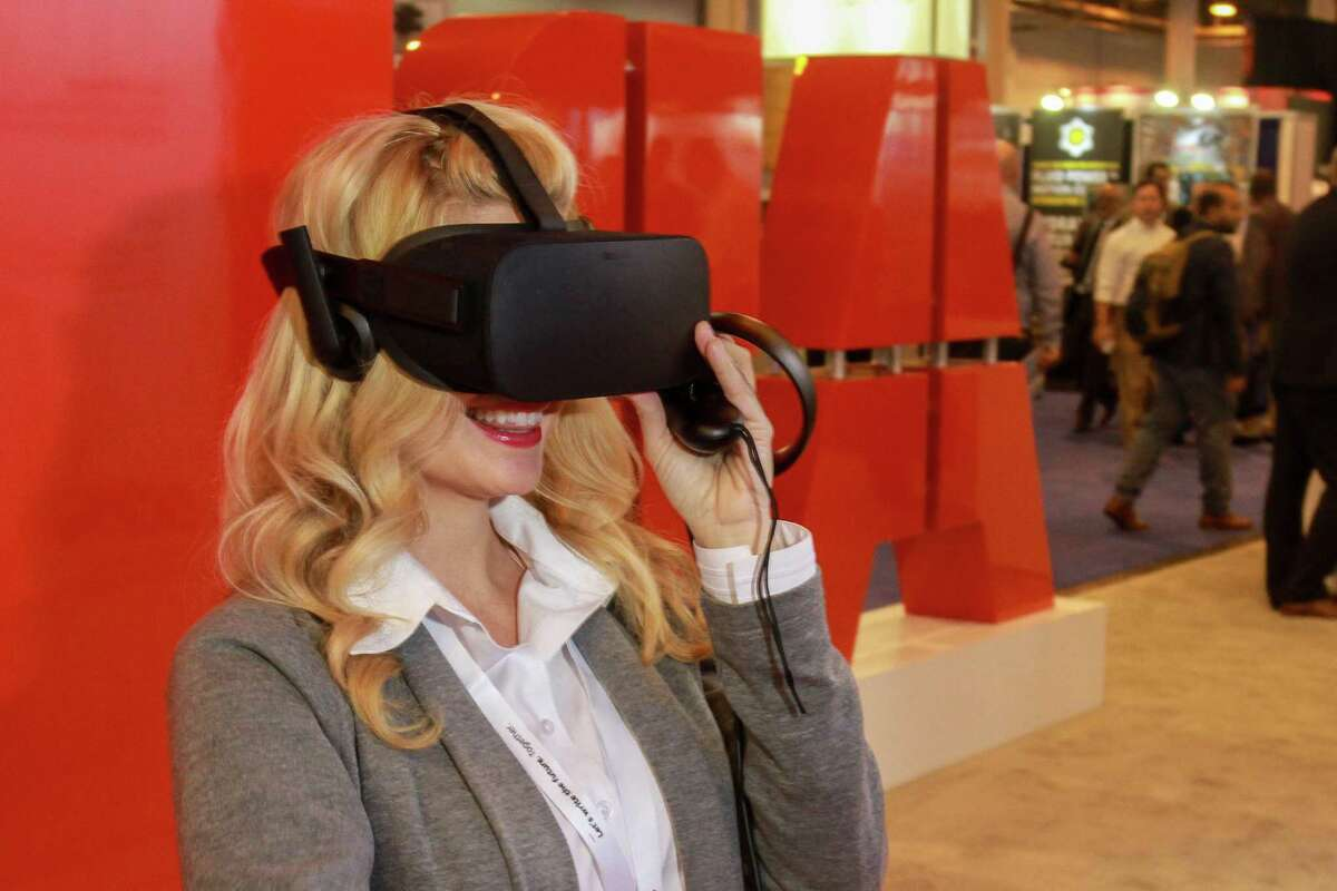 Hollie Winnard showing a virtual reality tutorial at ABB during OTC. (For the Chronicle/Gary Fountain, May 1, 2018)
