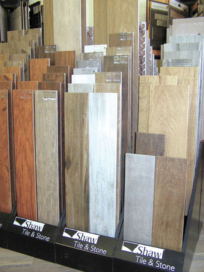 It looks like wood but it lives like tile. Tile that looks like wood is  arriving in homes across the Permian Basin every day! See this Shaw  Industries flooring at Southwest Floors, 1113 Andrews Highway. See this  Shaw Industries flooring at Southwest Floors, 1113 Andrews Highway. Photo: Paul Wiseman