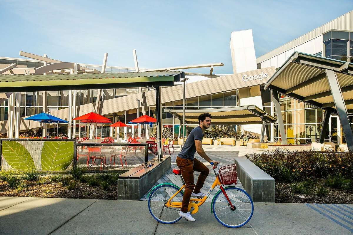 A biker rides through the Google campus in Mountain View, Calif., on Monday, Nov. 27, 2017.